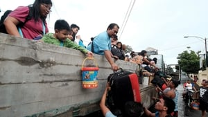 Stranded passengers from Tabaco port are evacuated by the local government in Tabaco City