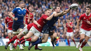 Leinster's Robbie Henshaw is tackled by Munster's Rory Scannell at the Aviva Stadium back in October