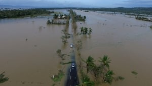 An aerial photo shows a flooded highway after typhoon Nock-Ten made landfall in Albay province