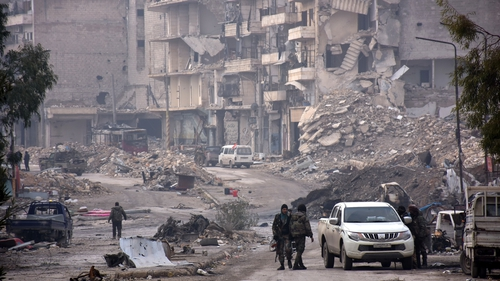 Syrian forces in the formerly rebel-held area of Sukkari in Aleppo