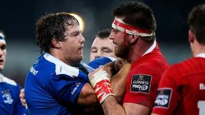 Munster's Jean Kleyn gets in a tussle with Mike McCarthy of Leinster
