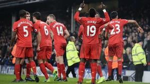 Liverpool players celebrate Sadio Mane's late, late Merseyside derby winner
