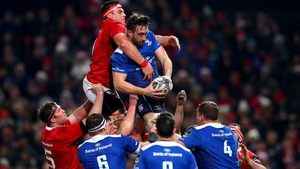 Munster's CJ Stander and Jack Conan of Leinster grapple for possession