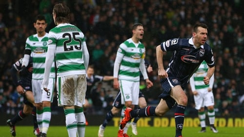 Paul Quinn celebrates scoring against Celtic in the Scottish League Cup semi-final