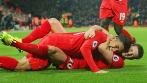 Firmino and Lallana celebrate a goal against Stoke City