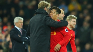 Klopp and Firmino embrace at the end of the 4-1 win over Stoke City