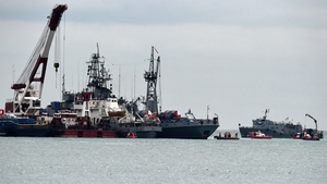 Rescue vessels search the Black Sea outside Sochi after the military plane crash