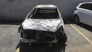 The burnt-out car which the Greek ambassador to Brazil rented