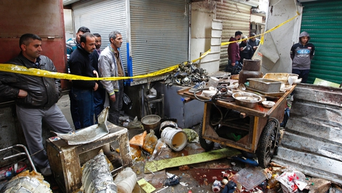 Police said the blasts went off near car spare parts shops in Sinak during the morning rush