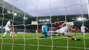 Benik Afobe opens the scoring for Bournemouth against rock-bottom Swansea