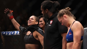 Ronda Rousey (R) hangs her head in defeat