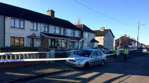 The woman was stabbed after she answered a call to her home at Oranmore Road in Ballyfermot