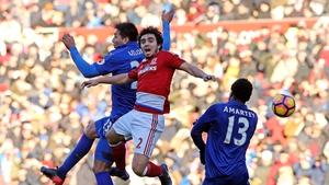 Leonardo Ulloa of Leicester Cit and Fabio Da Silva of Middlesbrough battle to win a header