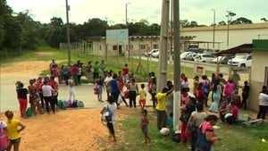 Crowds wait outside the prison in Manaus