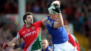 Ger Cafferkey battles Kieran Donaghy in the 2014 All-Ireland semi-final