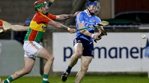 Cian O'Sullivan scores Dublin's first goal despite the attention of Carlow's Paul Doyle