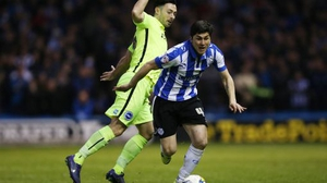 Richie Towell (L) in action in last season's play-off semi-final against Sheffield Wednesday, his only league appearance to date