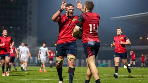 Billy Holland congratulates Andrew Conway following his late first-half try