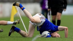 Longford's Barry O'Farrell falls face first after being tackled by a Kildare player