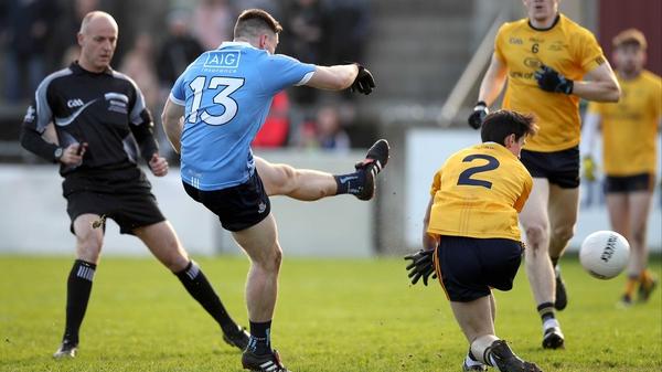 Dublin's Paul Hudson fires past Eoin Smith