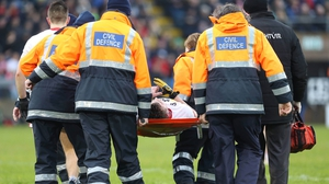 Connor McAliskey of Tyrone is taken off the pitch