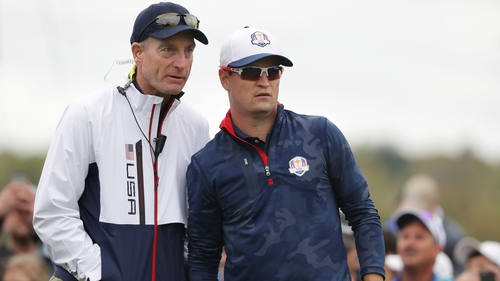 Jim Furyk (L) advising Zach Johnson as a vice-captain during the 2016 Ryder Cup