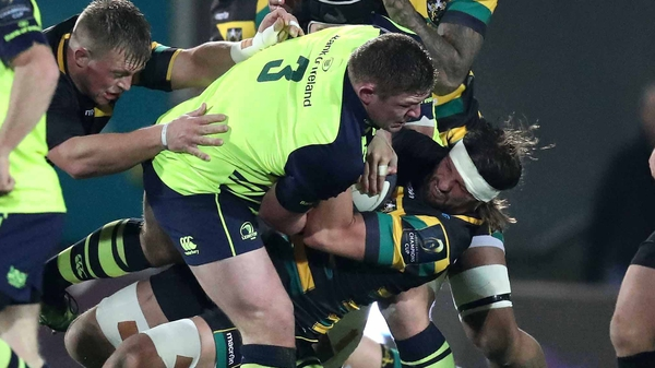 Leinster's Tadgh Furlong and Northampton's Tom Wood tussle for possession
