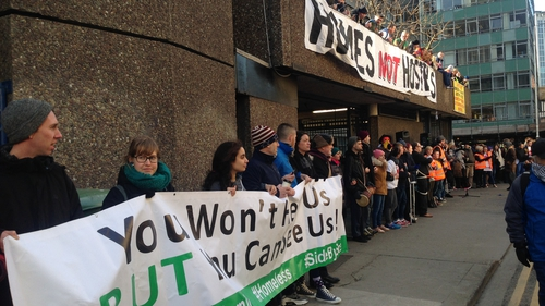 Supporters of the Home Sweet Home group gather outside the building