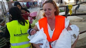 Anne O'Rorke helping to care for eight-week-old twins during her volunteer work in Izmir