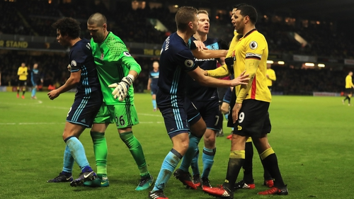 Watford and Middelsbrough players square up during the draw at Vicarage Road
