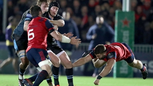 Munster's Jaco Taute (r) tackles Stuart Hogg of Glasgow Warriors