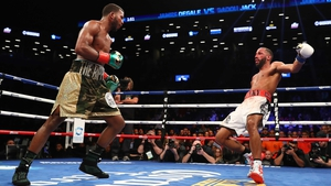 Badou Jack (L) knocks down James DeGale in the twelfth round
