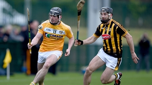Antrim's Ciaran Clarke with Conor Fogarty of Kilkenny