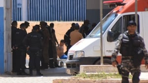 Authorities attend a wounded inmate inside the Alcacuz prison in Brazil