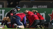 Murray is treated by medical staff against Glasgow Warriors