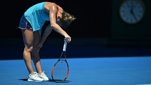 Simona Halep reacts during the defeat to Shelby Rogers