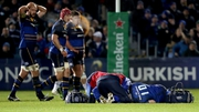 Sexton receives attention after a high tackle during the Champions Cup win over Montpellier