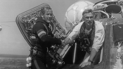 Eugene Cernan, Commander of the Apollo 17 lunar mission, is welcomed back to Earth by a US Navy Pararescueman