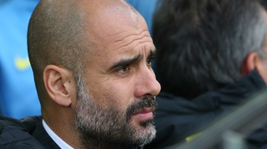 Pep Guardiola looks on as Man City struggle against Everton
