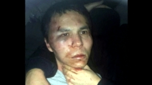 A battered and bruised Abdulgadir Masharipov was taken into police custody