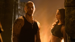 A striking-looking bald agent with xXx tattooed on the back of his neck goes undercover...