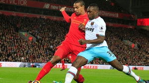 Joel Matip tackles West Ham's Michail Antonio at Anfield in December