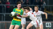 Jason McGee of Donegal and Tyrone's Jonathan Monroe