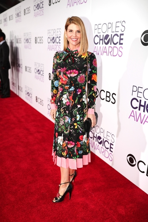 Lori Loughlin - the model and Full House actress is ahead of the of Spring/Summer '17 fashion trend of hyper florals and colour pop. Tick!