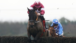 Ball D'Arc leads Pairofbrowneyes in the Dan Moore Memorial Chase at Fairyhouse