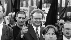 McGuinness gives a thumbs up during a march in London to commemorate the 25th anniversary of Bloody Sunday in 1997