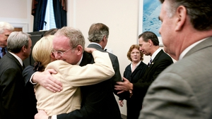 McGuinness embraces US Rep Carolyn McCarthy following a news conference on Capitol Hill after the IRA announces an end to its armed campaign