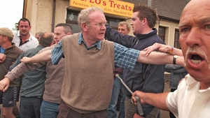 McGuinness tries to calm people as police remove protesters during 12 July events in Dunloy in 2005