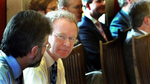 Adams looks past McGuinness prior to the start of the Good Friday Review in 2004