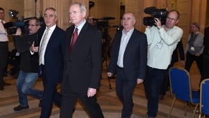 McGuinness walks through the Great Hall at Stormont after failing to nominate a candidate for the role of Deputy First Minister triggering a snap election